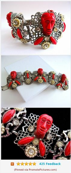 Signed SELRO Red African Face Mask Bracelet, Filigree, Thermoset & Rhinestones, Vintage #vintage #bracelet #selro #signedselro #redbracelet https://www.etsy.com/RenaissanceFair/listing/574277381/signed-selro-red-african-face-mask?ref=listings_manager_grid  (Pinned using https://PromotePictures.com)