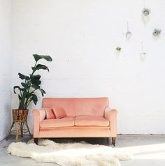 Romantics, don't bother with plain white furniture. This pretty peach love seat is in perfect vintage condition!
