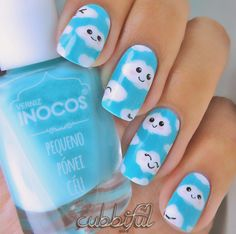 Adorable little cloud nail art looks really simple but effective