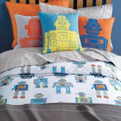 It's alive! After countless hours of tinkering around in their merchandising department, the powers that be at The Land of Nod brought these awesome robot sheets to life. The printed robot bedding features an army of blue, green, orange and silver marching robots. What an awesome bedroom decor idea for young boys. Discover more kids room decorating and organizing tips and ideas @ http://kidsroomdecorating.net