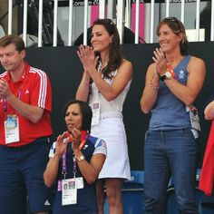 Kate pulls of her all white outfit while in the stands cheering at the 2012 Olympic Games.