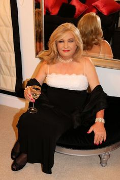 Transvestite Suzanne in a stunning evening gown with black silk wrap