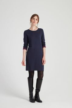 Long-sleeved dress with shaping and pockets. The clever construction of this dress combines the utility of pockets with flattering shaping.