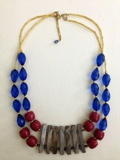 Color Block Statement Necklace  These color blocked acrylic, wood, and shell beads create a statement necklace that can add sparkle to an everyday outfit! By mixing bead types,