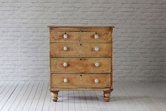 A Victorian pine painted Chest of drawers with porcelain knobs & decorative paint work. In original condition.