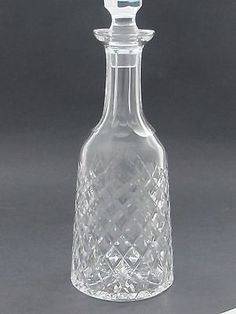 """Up for auction is this cut glass signed Waterford Hand Cut Irish Crystal Alana or Boyne decanter It is cut in the old tradition by stone wheel 13.5"""" Tall with stopper 4.25"""" in diameter and weighs 3.25"""