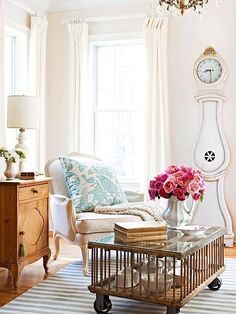 Love this light, bright, eclectically styled living area: and the chicken coop coffee table!