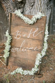 Welcome Sign || Baby's Breath Garland || See the wedding on Style Me Pretty: http://www.StyleMePretty.com/california-weddings/2014/02/17/mankas-boathouse-wedding-with-a-bowtie-bar/ Larissa Cleveland Photography