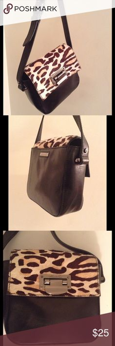 LAST CALL 💋 Animal Print crossbody bag 💋 Add a pop of flair to your outfit! 🍒 this is a a small smooth leather Crossbody bag by Kenneth Cole 🍒Black leather body and animal print fur flap 🍒 100% genuine leather and 100% genuine fur 🍒 magnetic closures for back pocket and bag opening 🍒dark silver hardware 🍒 adjustable long strap 🍒 OFFERS WELCOME😊 Kenneth Cole Bags Crossbody Bags