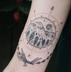 Tiny mountain, moon, evergreen compass with lavender on inner upper arm. By Pony Reinhardt in Portland, OR. For more, follow on IG: freeorgy