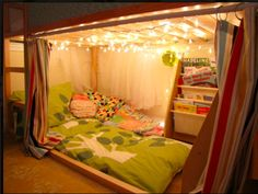 "All about creating reading nooks! Love! <3 I remember having ""Christmas"" lights in my room as a child and LOVING it.. Laying in bed reading a book at night under the glow was so cozy!"