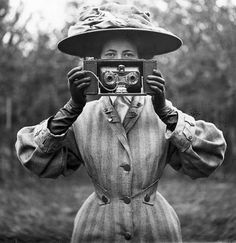 1900's Woman holding camera weird strange by Antiquephotoarchive