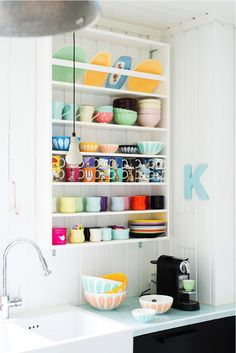 colorful collection of cups and mugs