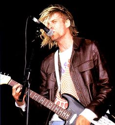 Nirvana - Reading Festival 1991.  Some would say that their 1992 headline performance was the moment that changed the band. But for me, seeing Kurt Cobain jump into the Drum kit after playing the hits that change everything..... Priceless