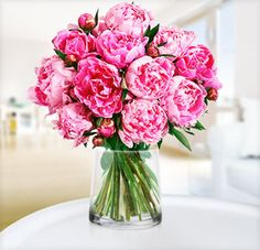 #Peonies in a simple clear glass jar will brighten any room. #Flowers
