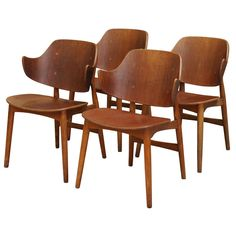 Ib Kofod-Larsen - Shell Chair, Set of four | From a unique collection of antique and modern dining room chairs at https://www.1stdibs.com/furniture/seating/dining-room-chairs/