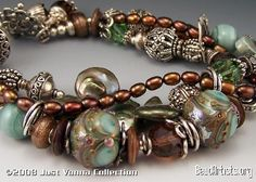 FBX Usually pinned here are single beads, but this was too amazing to go anywhere else.  Imagine wearing this bracelet.  The focals are done by a Canadian artist - who's website is pure eye candy.