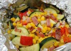 Summer Vegetable Grill Packets Servings: 4 2 slices bacon 4 ears fresh corn 1 red bell pepper, large diced 2 zucchini, cut in inch slices cup onion, diced 1 teaspoon cavender's all purpose Gr Foil Packet Dinners, Foil Pack Meals, Foil Dinners, Foil Packets, Healthy Side Dishes, Vegetable Side Dishes, Side Dish Recipes, Baked Vegetables, Grilled Vegetables