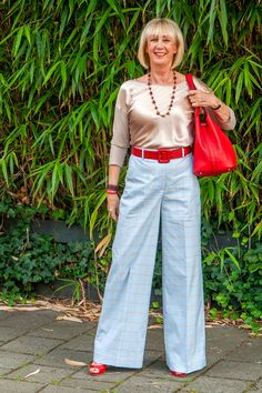 Blue checked pane trousers by Essentiel Antwerp. Red leather belt by Max Mara. Red leather tote by Midlifechic Fly London Boots, Hungarian Women, Walking Poses, Wide Pants, Sunday Outfits, Checked Trousers, Orange Dress, 50 Fashion, Signature Style