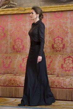 Don Felipe VI and Doña Letizia received the foreign diplomatic corps in Madrid.  Doña Letizia wore a Felipe Varela dress, a black sequined shirt style top and maxi length crepe skirt, paired with a black suede wide belt and accessorized the dress with Magrit black suede platform pumps. Doña Letizia wore her hair in a beautiful up-do which showed her black star-burst drop earrings with diamond hoops. 21/1/2015