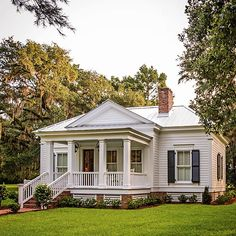 I have a small obsession with white homes and porches