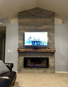 Vaulted ceiling electric fireplace floating mantle tv above fireplace. The post Weathered Grey rustic farmhouse style fireplace wall. Vaulted ceiling electric appeared first on Decoration. Above Fireplace Ideas, Fireplace Tv Wall, Fireplace Remodel, Fireplace Surrounds, Fireplace Design, Tv Above Mantle, Fireplaces With Tv Above, Tv Mantle, Wall Fireplaces