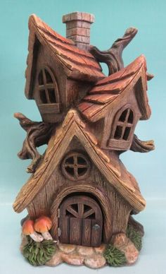 Add to the whimsy of your fairy garden with this stunning miniature Tri-house complete with windows and wooden door, and a chimney. Young and old, everyone enjoys the magic of a fairy garden, and this fairy garden house is destined to impress. Fairy Tree Houses, Clay Fairy House, Gnome House, Fairy Garden Houses, Garden Homes, Fairy Village, Garden Sheds, Ceramic Houses, Clay Houses
