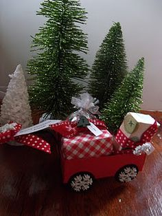 Christmas delivery, tiny little wagon made of paper filled with presents, tree and even a little plate of cookies