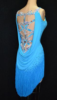 Blue fringe latin dress with intricate back design and stoning from Designs to Shine. Visit http://ballroomguide.com/comp/attire/lady.html for more info about competition attire.