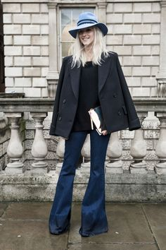 LFW Street Style Day 1: She perfected the downtown vibe with a wide-brim hat and bell-bottoms.