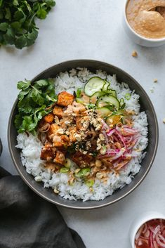 These Spicy Peanut Tofu Bowls with Quick Pickled Veggies are a super delicious, flavor-packed plant based meal! The tofu is baked and tossed in a spicy peanut sauce, then served over rice with quick p Tofu Recipes, Asian Recipes, Healthy Recipes, Steak Recipes, Quick Vegetarian Recipes, Carrot Recipes, Healthy Food Blogs, Vegetarian Dinners, Roast Recipes