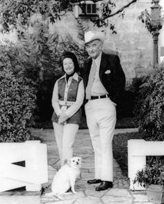Former President Lyndon B. Johnson and his wife, Lady Bird, pose with their dog Yuki to mark their 38th wedding anniversary in November 1972.