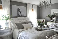 Gray, white, silver bedroom. (Needs more color, but I like the mismatched furniture)