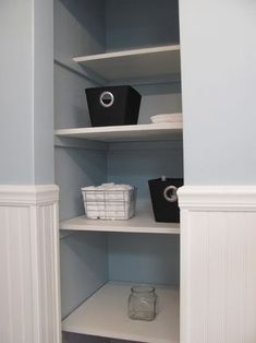hmm... remove closet door in bathroom and use pretty containers for open shelving?