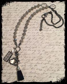 Stay Strong.....fun, long beaded charmed/tassel necklace! www.nanettemc.etsy.com