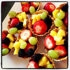 Bridal shower food. Keebler waffle cups filled with strawberries, pineapple, black berries, and grapes.