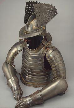 Work of Art  Half-Armour Author: Country:Germany Collection:Arms and Armour Date:Early 17th century Technique:forged, carved, chased, engraved and gilded
