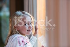Face of a little girl looking through a window royalty-free stock photo