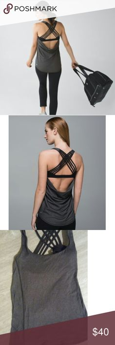 Free to be wild Lululemon Lululemon wild tank slate grey, black with faint gold stripes and solid black bra. No flaws.Smoke free home. Only selling because it does not fit, I bought the wrong size😞.  Size small/ 6. lululemon athletica Tops Tank Tops