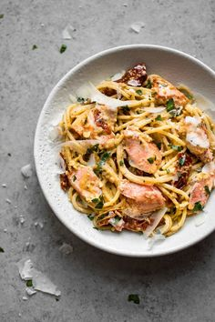 This creamy Cajun salmon pasta is full of flavor with a touch of spice! The perfect easy weeknight dinner that's good enough for guests. food from recipes Cajun Salmon Pasta Recipe, Salmon Recipes, Fish Recipes, Seafood Recipes, Dinner Recipes, Cooking Recipes, Healthy Recipes, Cooking Rice, Dinner Ideas