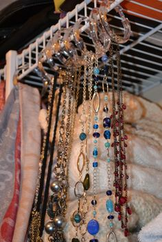 Jewellery and scarf organization with Dollarama clear shower curtain rings.