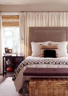 Link to great ideas for head of bed wall window treatments. Windows and exterior of master bedroom wall where head of bed will sit.  Iloft & cottage: what to do with a window behind the bed?