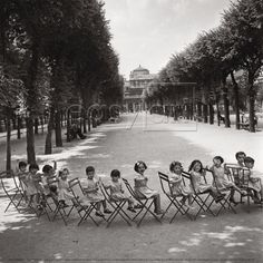 Children in the Palais-Royal garden, 1950  by Robert DOISNEAU