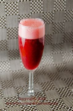 Mixed Berry Bellinis from Hot Eats and Cool Reads! This is the perfect cocktail for New Year's!