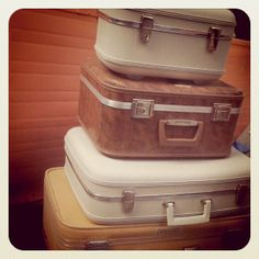 LOVE the ballsiness of WHITE vintage luggage!