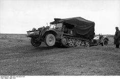 A Demag Kfz 10 light halftrack towing a anti tank gun traveling at speed