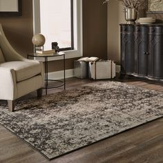 Follow the trendy over-dyed look with this transitional black area rug. This stunning rug is washed with several shades of grey and black, giving it a unique look. Made from polypropylene material, this rug is sturdy as well as stylish.