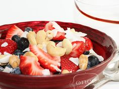 """Berries, Nuts, and Coconut Shreds """"Cereal"""" that is Whole 30 compliant. How yummy to drizzle with some coconut milk!?! All you would need is a few hard boiled eggs and some veggies and you would be set! What a great quick whole 30 breakfast (or lunch!)"""