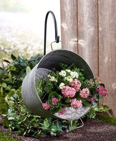 Grow your favorite flowers in this rustic Hanging Pail Planter with Shepherd's Hook. The pail is made of galvanized metal and has 2 handles, one o #rusticoutdoorplanter