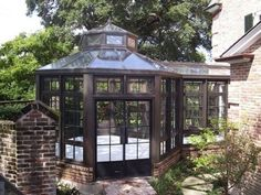 Hexagonal garden room with what looks like a glass connecting hall.   LOVE!